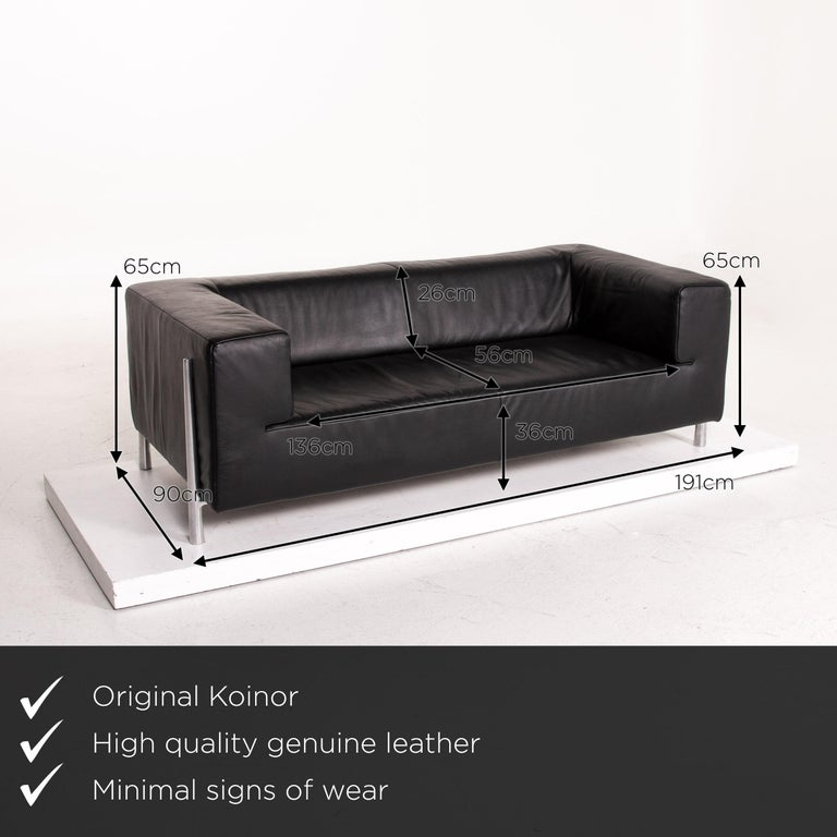 We present to you a Koinor Genesis leather sofa black two-seat couch.       Product measurements in centimetres:     depth: 90  width: 191  height: 65  seat height: 36  rest height: 65  seat depth: 56  seat width: 136  back height: 26.