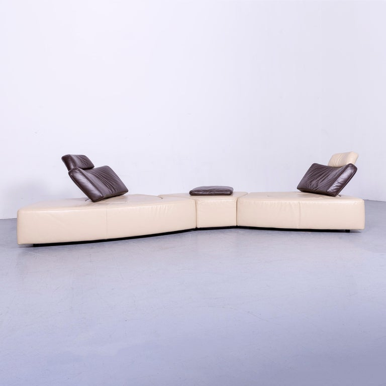 We bring to you an Koinor leather corner sofa off-white or brown four-seat function.