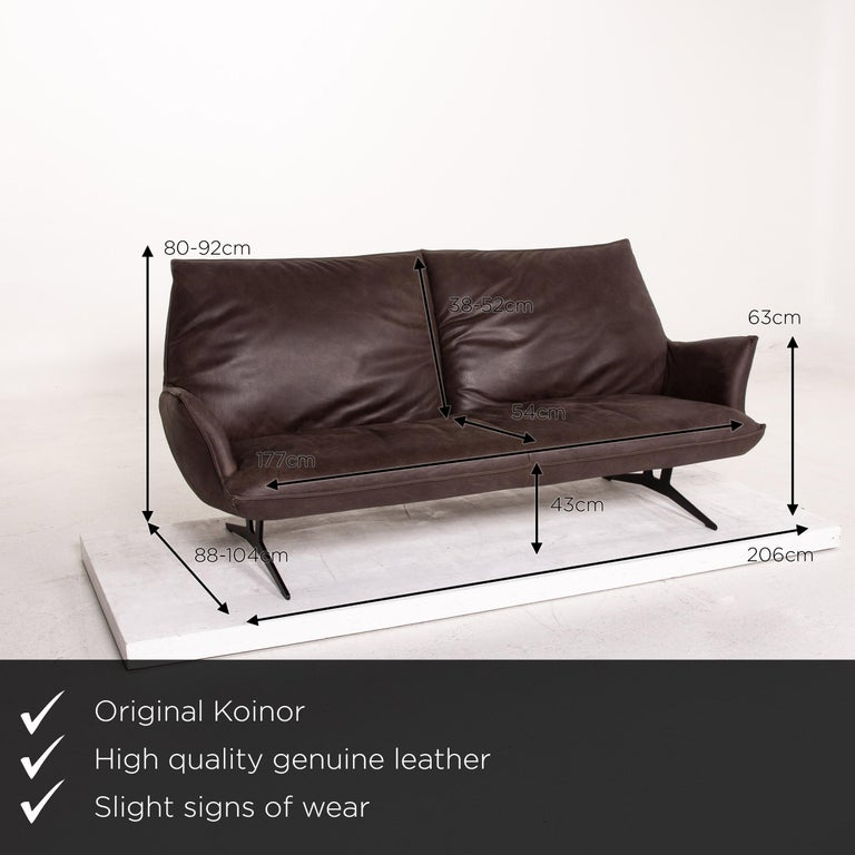 We present to you a Koinor leather sofa brown dark brown three-seat function couch.    Product measurements in centimeters:    Depth 88 Width 206 Height 92 Seat height 43 Rest height 63 Seat depth 54 Seat width 177 Back height 52.
