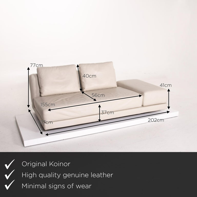 We present to you a Koinor leather sofa cream three-seat function couch.     Product measurements in centimeters:    Depth 107 Width 202 Height 77 Seat height 37 Rest height 41 Seat depth 56 Seat width 155 Back height 40.