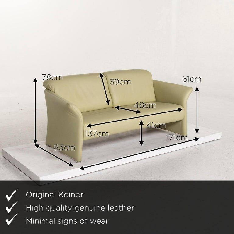 We present to you a Koinor leather sofa green three-seat couch.    Product measurements in centimeters:    Depth 83 Width 171 Height 78 Seat height 41 Rest height 61 Seat depth 48 Seat width 137 Back height 39.