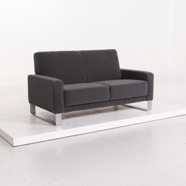 We bring to you a Koinor Nove fabric sofa gray compact sofa two-seat couch.     Product measurements in centimeters:    Depth 85 Width 143 Height 80 Seat-height 41 Rest-height 52 Seat-depth 55 Seat-width 118 Back-height 39.