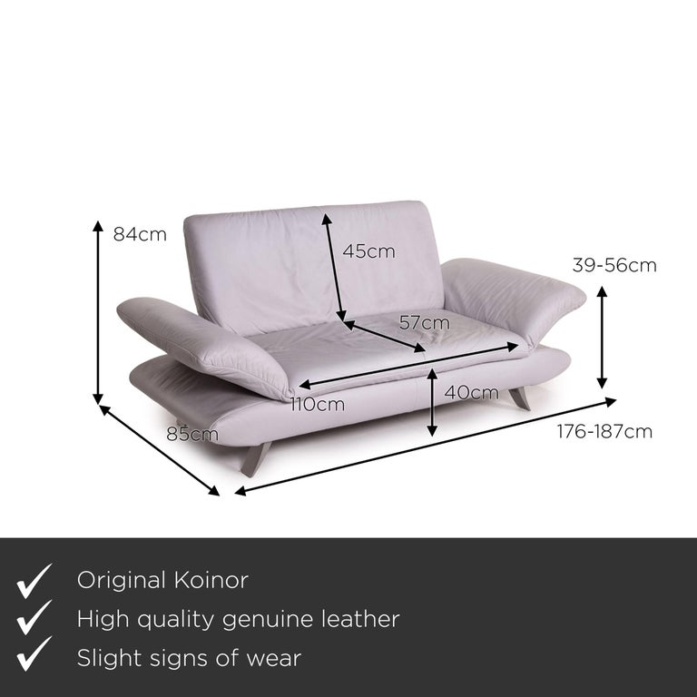 We present to you a Koinor Rossini leather sofa gray gray blue two-seat function couch.     Product measurements in centimeters:    Depth 85 Width 187 Height 84 Seat height 40 Rest height 39 Seat depth 57 Seat width 110 Back height