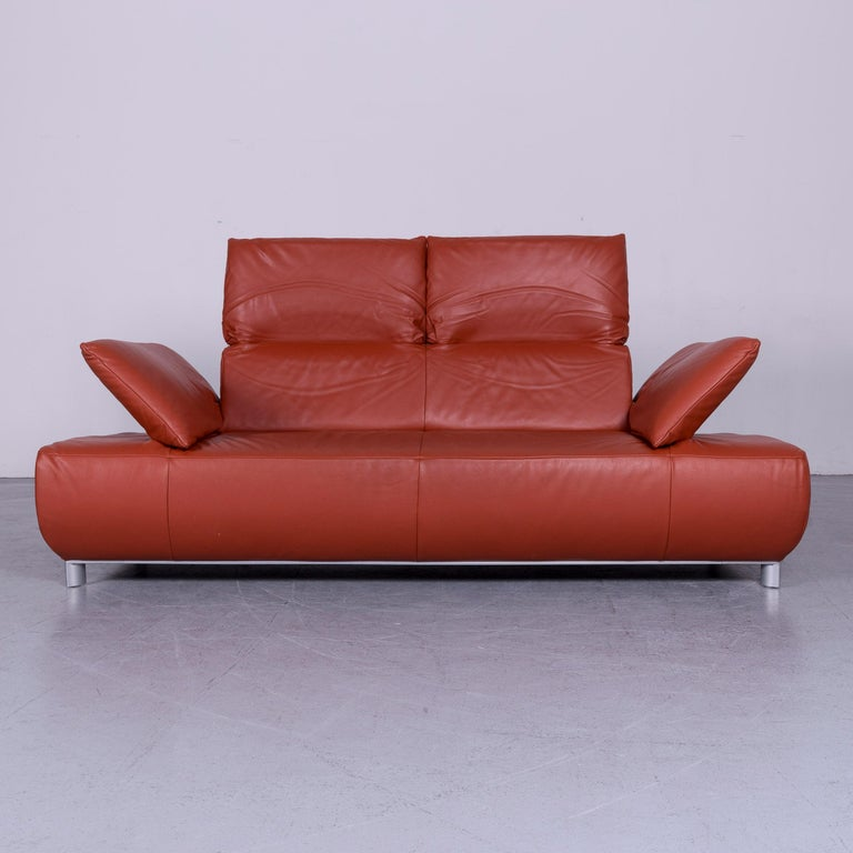 We bring to you an Koinor Volare designer leather sofa red three-seat couch with function.