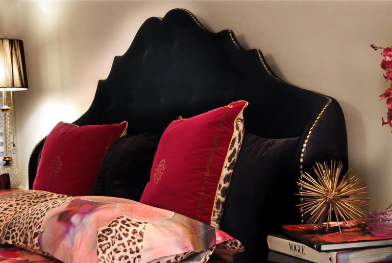 Nothing says sultry Hollywood boudoir like the Alexia Bed. Her fully upholstered headboard's sensuous curls and curves draw you down to the tufted accents and vivacious golden nails lining the side. A lady and a flirt, her playful platform body