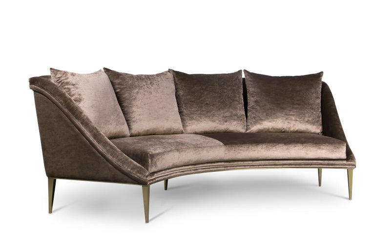 Designed to perform in a matter that indulges the eyes, the Geisha's curves grace a room with the extravagance and poise of a Kyoto Geisha. Her fully upholstered curved body rests on modern and sleek.  Options: Upholstery: Available in any fabric