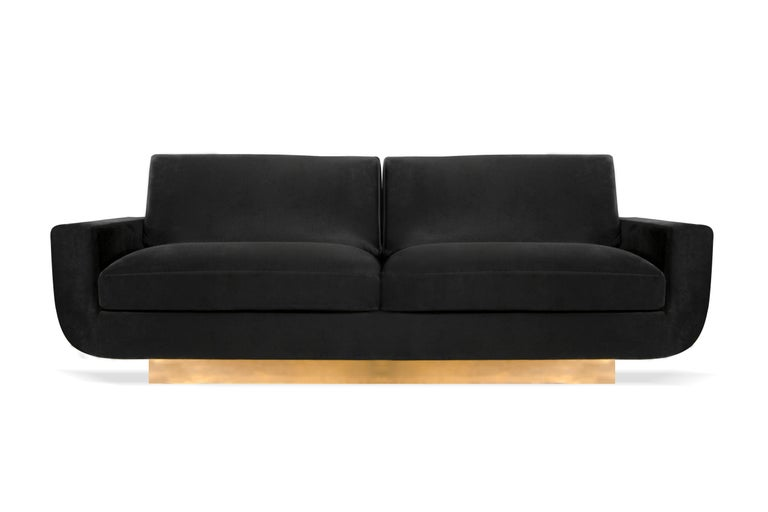 Mid-Century Modern design has never looked so posh as the Sofia sofa. Her two-seat, vintage shape is modernly revamped by Koket with her plush curves being cupped by a lustrous, linear metal base.  Options Upholstery: Available in any fabric from