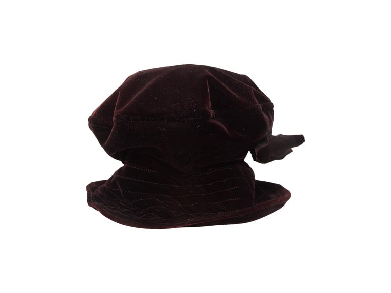Product Details: Vintage wine and black velvet hat by Kokin. Bow accent at front. 7