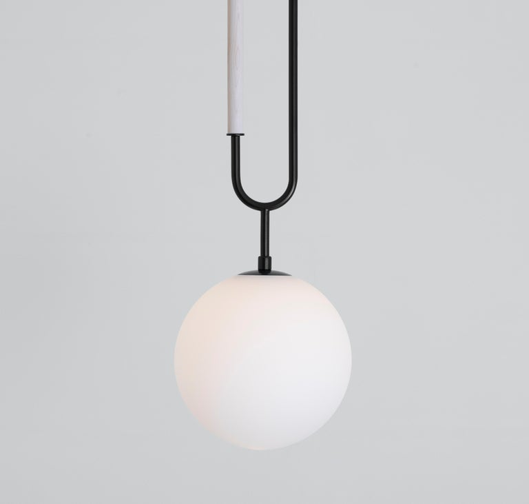 Art Deco Koko, a Modern Pendant Light with Satin Globe Shade in Matte Black and Wood For Sale