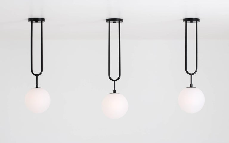 Koko, a Modern Pendant Light with Satin Globe Shade in Matte Black and Wood For Sale 1