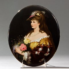 KPM Oval Plaque depicting a Beautiful Lady with a Hat