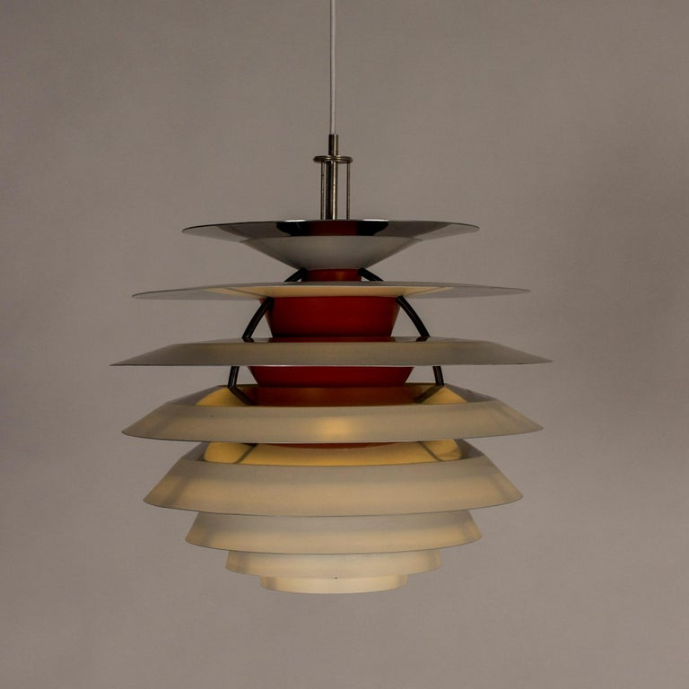"""Striking """"Kontrast"""" pendant lamp by Poul Henningsen. Lacquered white on the outside and orange red and purplish blue on the inside. Spreads an amazing light, looks amazing both when lit and unlit."""
