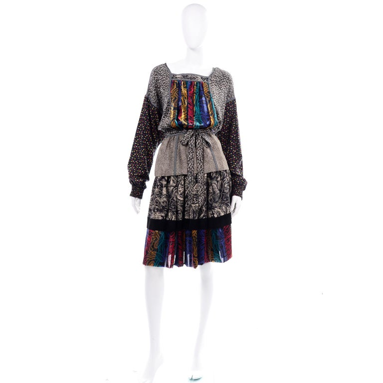 We absolutely love this vintage Koos Van den Akker couture two piece dress! We have always admired the ability Van den Akker had to mix textures and designs into a cohesive pattern. This incredible collage style print outfit includes a  skirt and a
