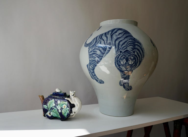 Korean blue and white porcelain vase with tiger cat design.  Decorated in cobalt blue with a design of tiger and bonsai tree, stoutly potted and glazed with a clear glaze of faintly aqua tint. Measures: Diameter 48 cm. Height 50 cm. Weight 11 kg.