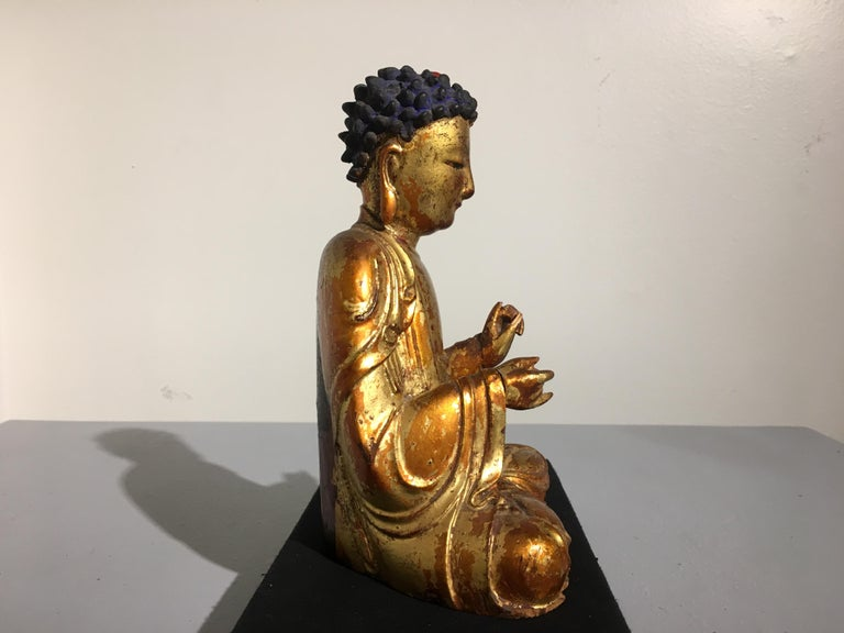 A sublime and well carved Korean lacquered and gilt wood figure of Amitabha Buddha (Amita Bul), Joseon Dynasty, early 19th century, Korea. 