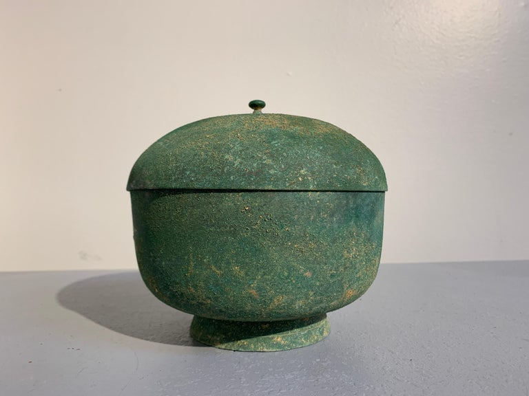 A fine Korean spun bronze bowl and cover with nice malachite green patina, Goryeo Dynasty, 13th century.