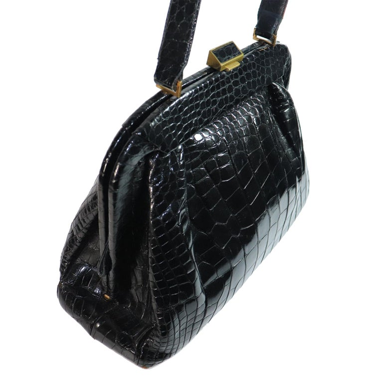 Koret Black Alligator Large Top Handle Bag made in America, comes with attached coin purse and a Kent London pocket Comb. VERY RARE    Measurements:  Height - 9.5 inches  Width - 15 inches  Height with Strap - 16.2 inches