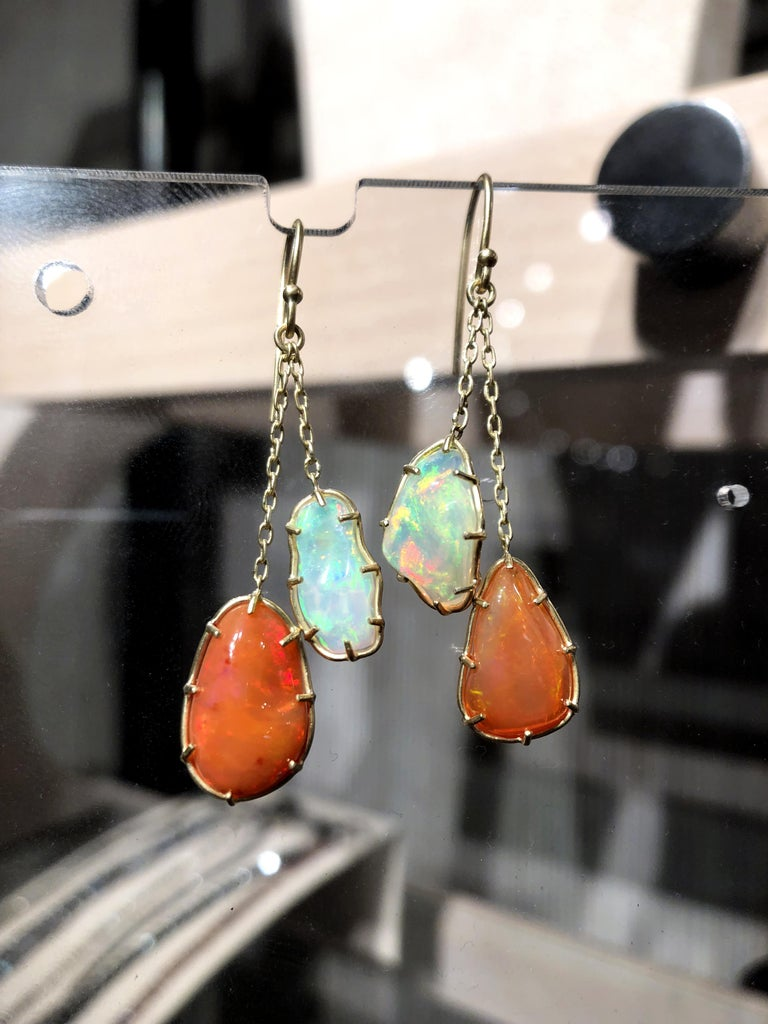 One of a Kind Yin Yang Earrings handmade by jewelry artist Tej Kothari in matte-finished 18k yellow gold showcasing four vibrant freeform Mexican opals that feature the two extraordinarily unique yet complementary hues of the gemstone species.