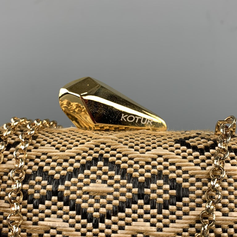 KOTUR Handbag comes in beige and black tones in a fabric woven material, with a gold chain, a gold metal tone hardware at closure, and a inner pocket.   Excellent Pre-Owned Condition.   Measurements:   Length: 6.5 in. Width: 2 in. Height: 4.5 and