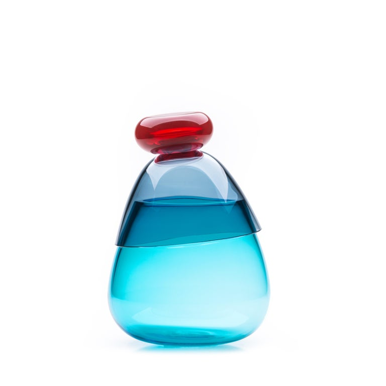 21st century Karim Rashid Kount vase Murano glass various colors. Kount is composed of discrete elements, a bowl and a vase, that can combine to form a stunning centrepiece. Used singly, they can be adapted for different purposes, whether aesthetic