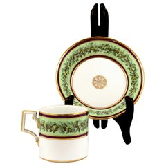 KPM Empire Porcelain Cup and Saucer Decorated with a Green Flower Border