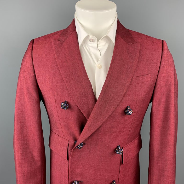KRIS VAN ASSCHE sport coat comes in a burgundy viscose blend with a full liner featuring a peak lapel, flap pockets, silk knot button details, and a double breasted closure.  Very Good Pre-Owned Condition. Marked: 46  Measurements:  Shoulder: 17