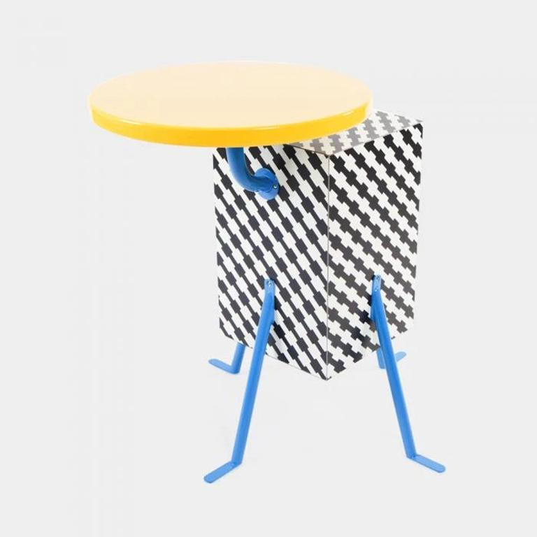 Kristall end table in plastic laminate, lacquered wood and metal. Designed in 1981, by Michele De Lucchi for Memphis Milano.   Michele De Lucchi was born in 1951 in Ferrara and graduated in architecture in Florence. During the period of radical and
