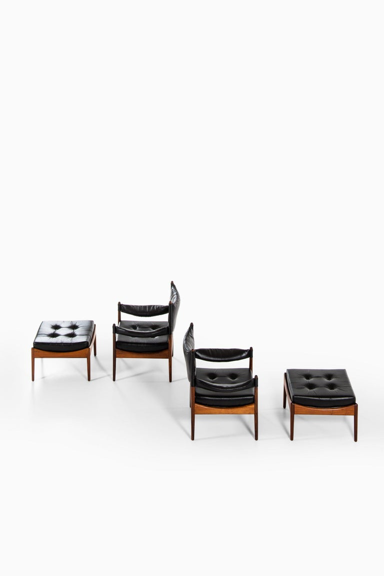 Rare pair of easy chairs with stools model Modus designed by Kristian Solmer Vedel. Produced by Søren Willadsen møbelfabrik in Denmark.