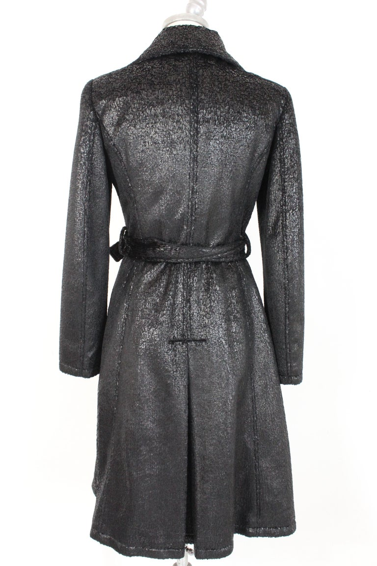 Krizia Jeans vintage 80s women's coat. Long flared coat, laminate black color. Button closure and adjustable belt. Two pockets on the hips. 95% polyester fabric, 5% polyurethane. Made in Italy.  Condition: Excellent  Item used few times, it remains