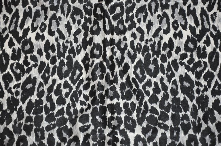 Krizia wonderfully detailed majestic black and steel gray leopard print silk scarf is accented with hand-rolled edges and measures 34 inches by 34 inches. Made in Italy.