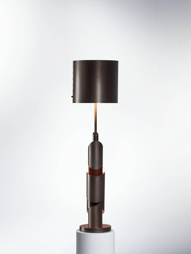 KRS I - table lamp - signed William Guillon Limited edition of 12 Signed and numbered Solid aluminium, smoke nickel / copper finish. Sand-blasted / Polished Dimensions: 89 x 23 x 23 cm Hand sculpted in France KRS I    Collapse