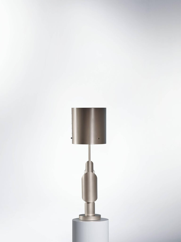 KRS I, table lamp, signed William Guillon Limited edition of 12 Signed and numbered Solid aluminium, smoke nickel / copper finish. Sand-blasted / Polished Dimensions: 64 x 19 x 19 cm Hand sculpted in France KRS III  Collapse