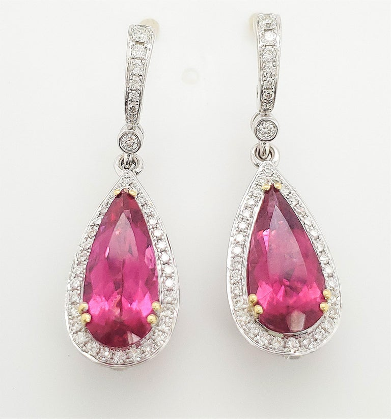 Authentic Charles Krypell dangle earrings made in 18 karat white gold set with approx. 2.35 carats of round brilliant cut diamonds (E-F color, VS clarity). Rubelite drops weigh an estimated 13 carats total. Signed C. Krypell, 18K, D235 R713. The