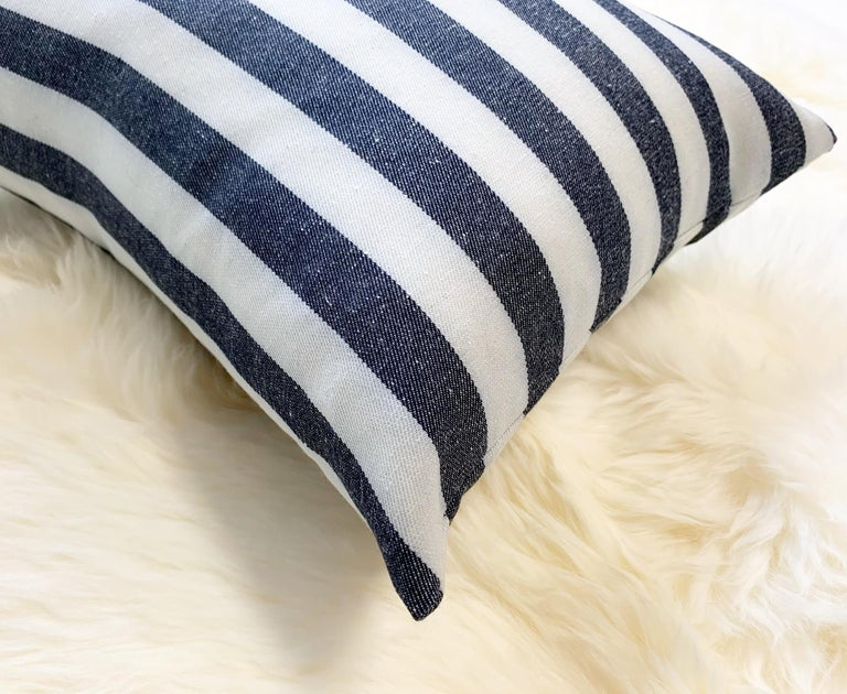 "Kule's incredibly chic stripe fabric was used to make this beautiful pillow crafted in our Saint Louis studio. Down feather insert included. Measures: 11 x 16""."