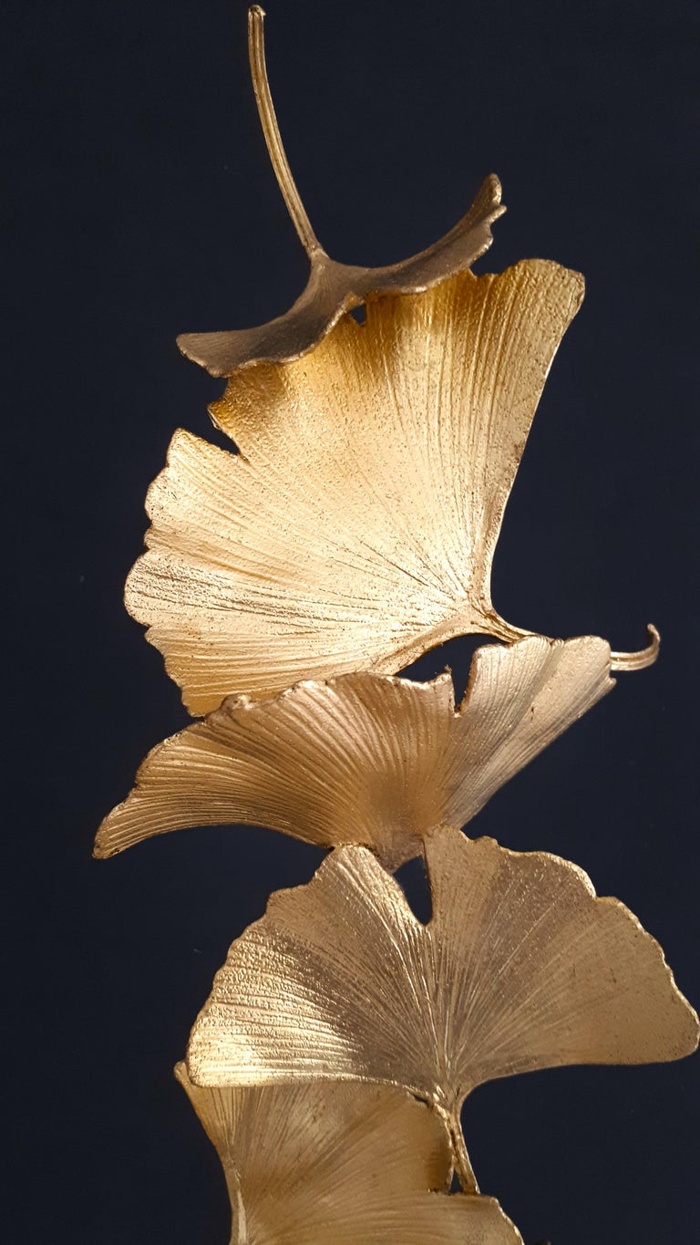 Artist: Kuno Vollet  Title: Golden Gingko with 6 leaves art sculpture  Materials: Cast brass, gold leaf, black granite base (rough or smooth finish available)  Size: 60 x 9 x 9 cm  24k gilded leaves - cast