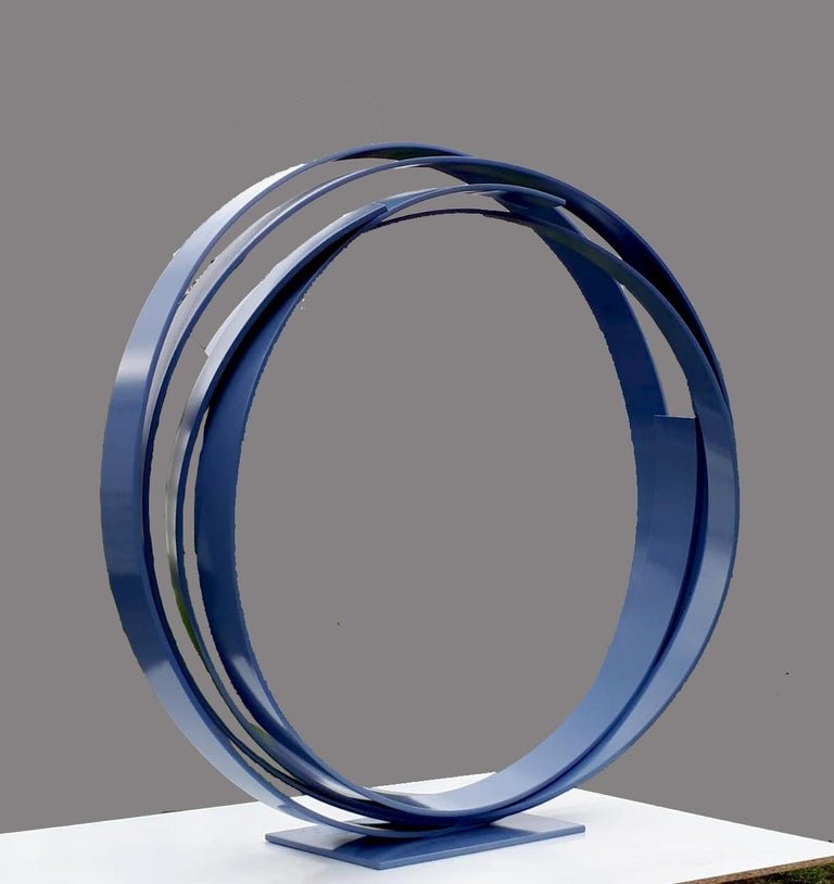 A large contemporary blue steel sculpture. Beautiful on the floor or a pedestal.  A contemporary statement piece full of elegance and movement. _______________________________________________________________________  About the Gallery: Folly and