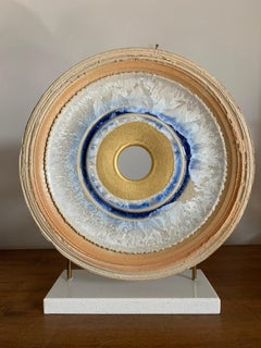 Infinity Diamond by K. Vollet - gold, blue circular sculpture on granite base