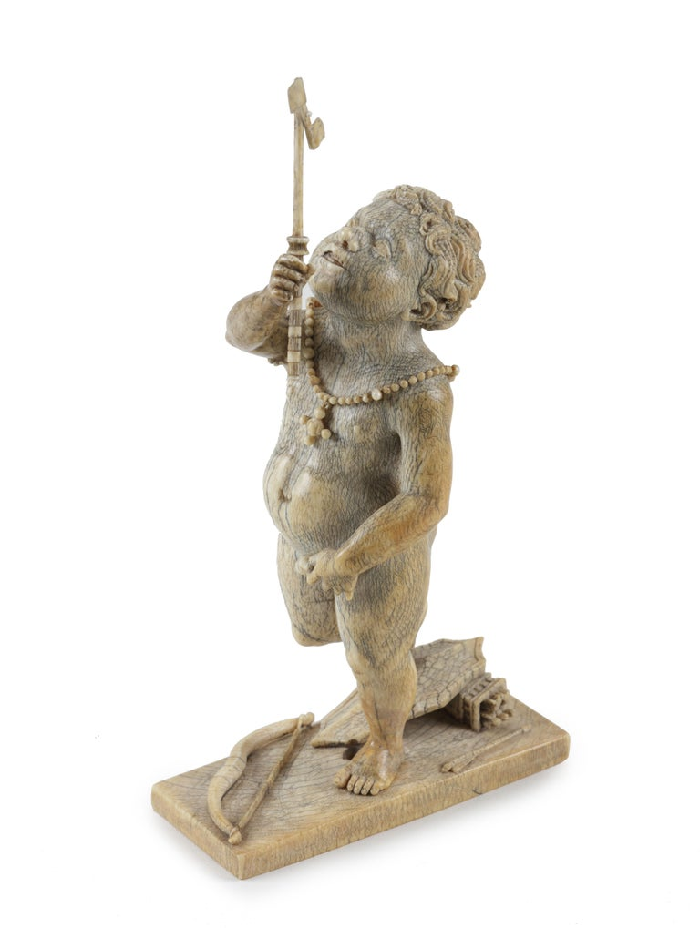 An ivory figure of an African(?) Amor
