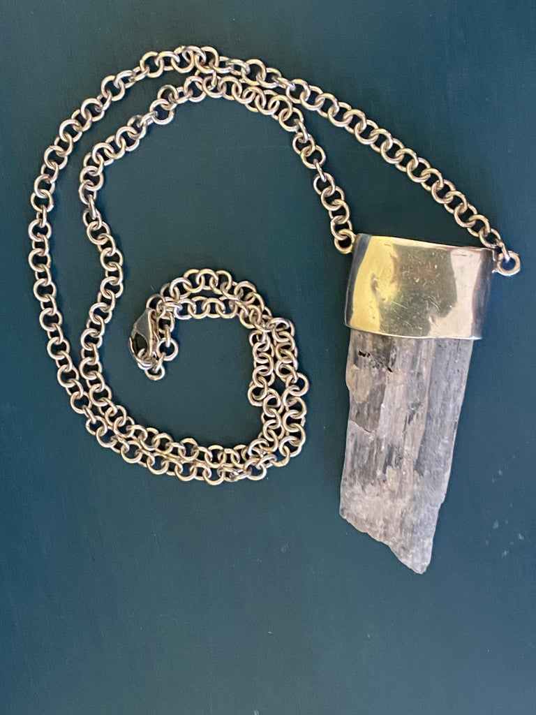 Chunky Uncut large Kunzite Crystal set in a top bezel of Sterling Silver and a Rolo style chain with a generous Lobster Claw Clasp. Bohemian Chic Fashion styled necklace that will match any outfit. Measures 14 inches in length.