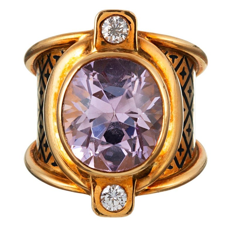 Polished strokes of 18 karat gold bathe the center 10 carat kunzite in golden light, while brilliant diamonds (.22 carats in total) are set in square stations at the North and South compass points. This uniquely stylized ring boasts bold