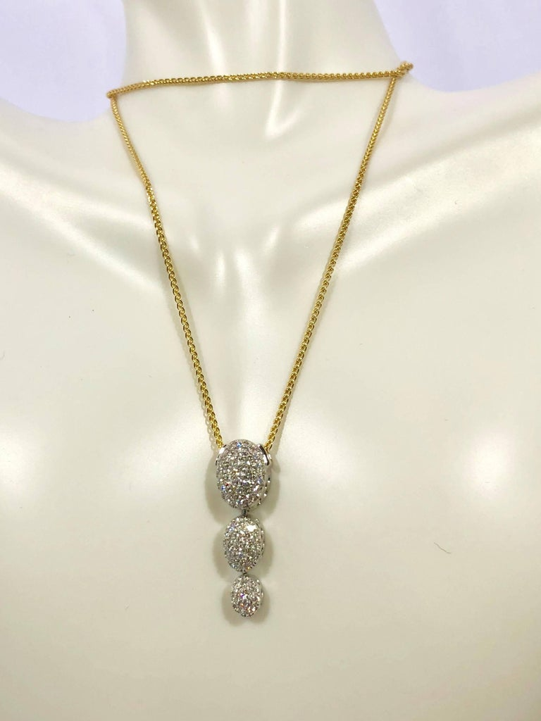 18 Karat white gold diamond pendant by Kurt Gutman, 48- full cut round diamonds = .52 carat total weight, average color G-H, average clarity VS2-SI1, approx. one inch long, weighing 4.5grams/2.9dwt., insurance appraisal provided upon purchase.