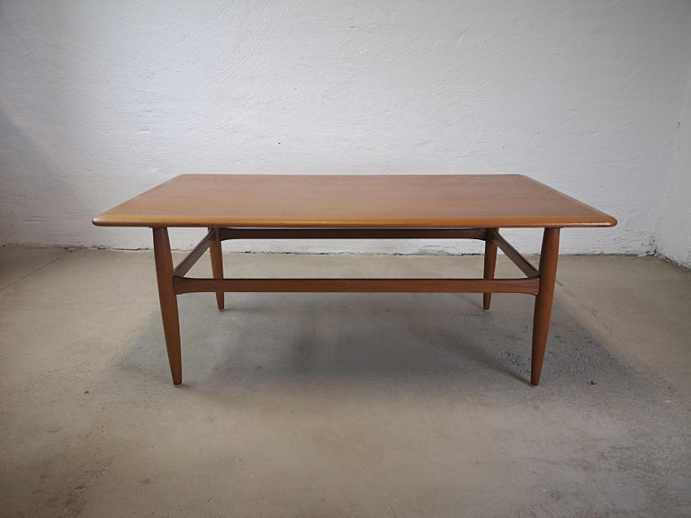 A nice coffee table from Jason Möbelfabrik in Denmark design by Kurt Ostervig and made out of solid teak. All sides of the top are rounded and the legs are beautifully tapered. The coffee table is of high quality.   The top is in excellent