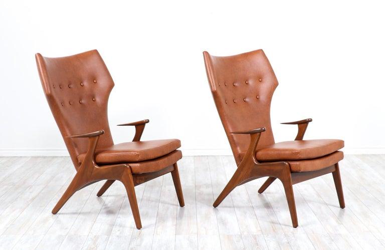 Kurt Østervig cognac leather wing chairs for Rolschau Møbler.