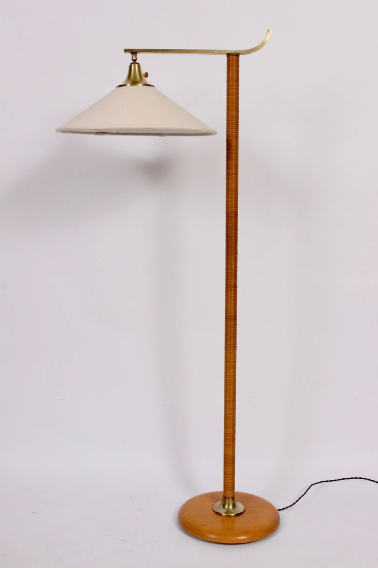 Kurt versen maple rattan and brass floor lamp with linen shade rare late art deco kurt versen maple and rattan reading floor lamp with brass details aloadofball Image collections