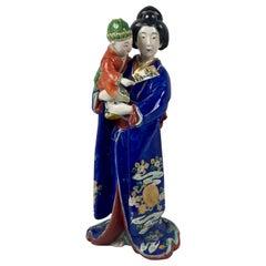 Kutani Porcelain Figure of a Bijin with a Child, Japan, Meiji Period