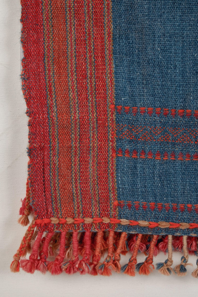 Handwoven wool throws with hand twisted tassels. Orange and indigo blue. Slightly fuzzy weave. Made in Kutch area of Gujarat, India.