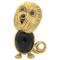 Kutchinsky 18 Carat Gold Dog Brooch with Onyx Body and Sapphire Eyes and Nose