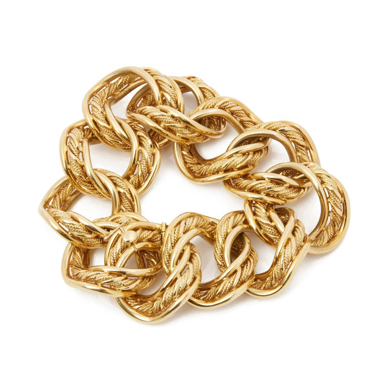 Code: COM2140 Brand: Kutchinsky Description: 18k Yellow Gold 1960's Heavy Link Vintage Bracelet Accompanied With: Box Only Gender: Ladies Bracelet Length: 19.5cm Bracelet Width: 3cm Clasp Type: Hinge Condition: 8 Material: Yellow Gold Total Weight: