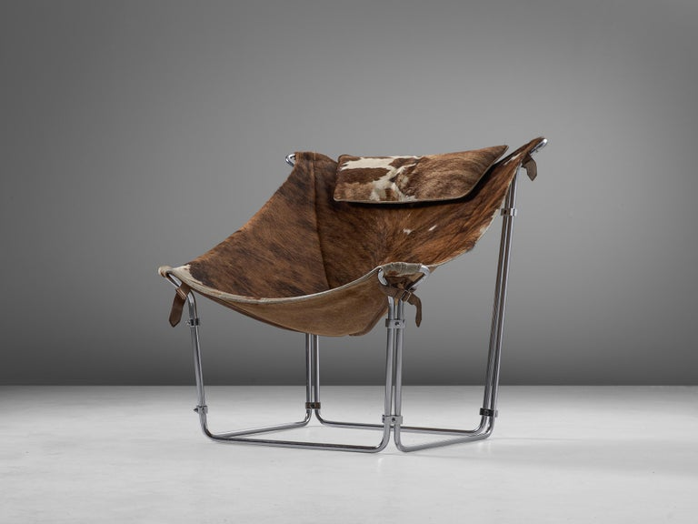 Kwok Hoi Chan for Steiner, lounge chair 'Buffalo', cow hide, tubular steel, France, 1969  This extraordinary lounge chair by Kwok Hoi Chan is produced by Steiner, Paris. What marks this design is the frame made of tubular steel in which a natural