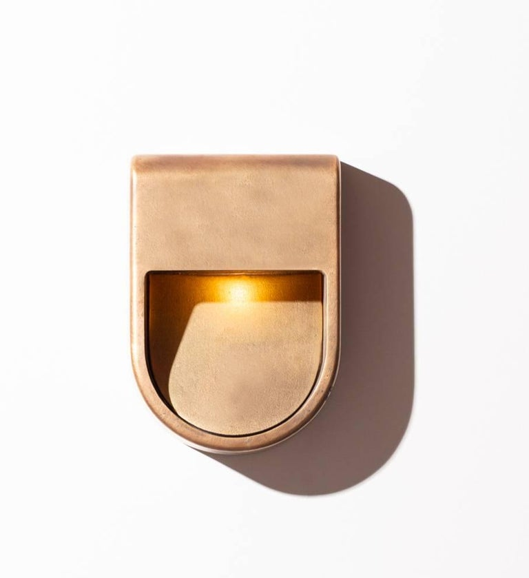 Kyoto is a unique outdoor/indoor lamp collection. Sand cast in aluminium. Finish options are raw aluminium, blackened aluminium, brass, bronze and silver. The sconces are handmade sculptures that are resistant to the elements.  Each piece is
